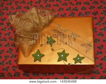 Very luxury wrapping gift with bow and stars