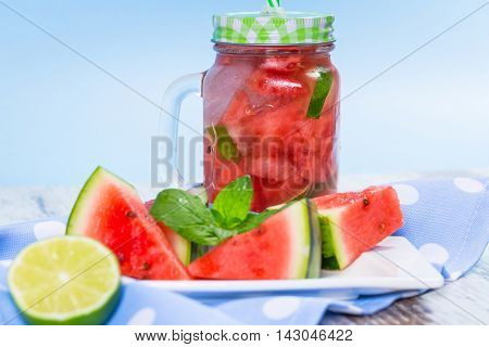 Watermelon and lime lemonades on kitchen table