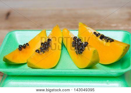 Ripe sweet papaya on green background. Papaya. Close-up