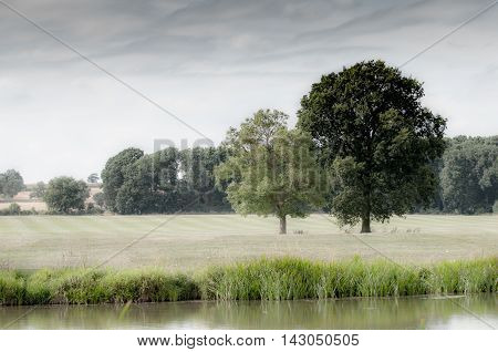 Countryside landscape in rural English countryside by the riverside