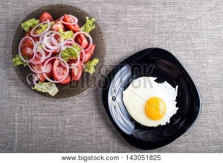 Top View Of A Healthy Homemade Breakfast Of Fried Egg And A Salad