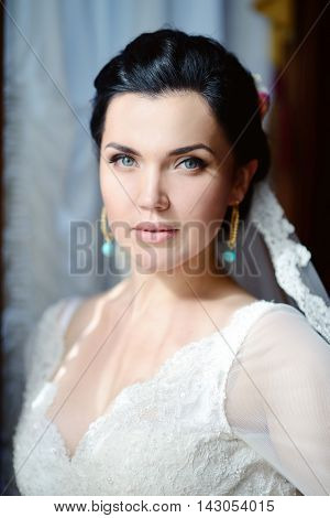 Beauty Bride In Bridal Gown With Lace Veil Indoors. Beautiful Model Girl In A White Wedding Dress. F