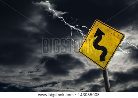 Winding Road Sign With Stormy Background