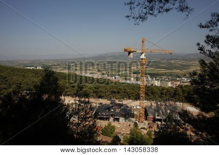 building construction work, tower cranes working , blue sky under