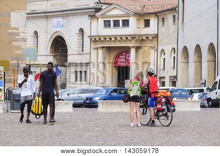 MANTUA, ITALY - JULY, 23, 2016: tourists on a square infront of Ducal Palace in Mantua, Italy