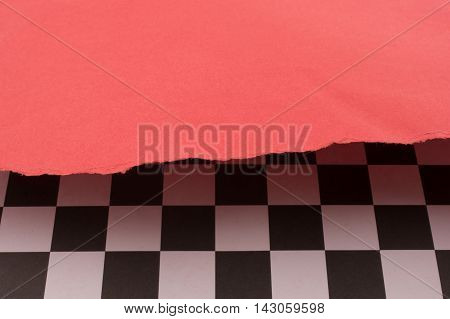 Red paper and black and white checked board pattern