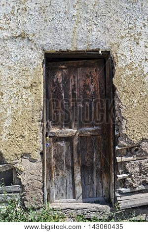 Old door on a semi collapsed rural home