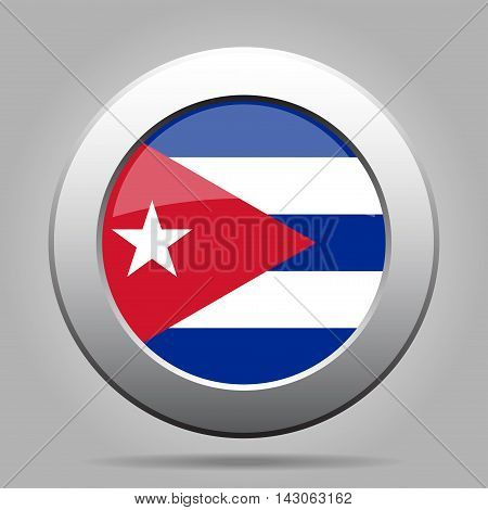 metal button with the national flag of Cuba on a gray background