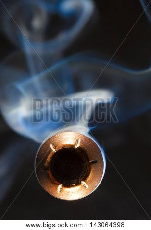 Copper plated bullet with a hollow point coming at the camera