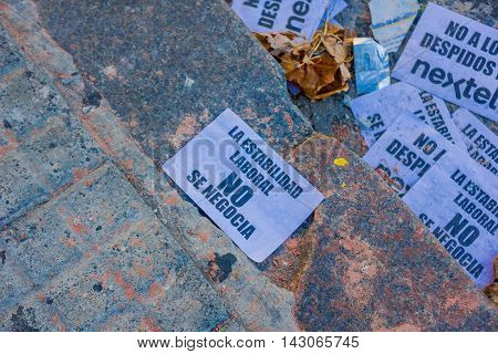 BUENOS AIRES, ARGENTINA - MAY 02, 2016: some small protest messages lay on the street after the march against a phone company.