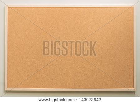 rectangle brown cork board on white wall background