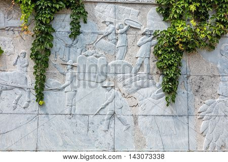 emboss wall which illustrate harvest of agriculture of Chinese