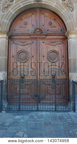 Quito, Pichincha / Ecuador - August 16 2016: Detail of Gateway to the Catedral Primada de Quito. The historic center was declared by UNESCO the first Cultural Heritage on 1978