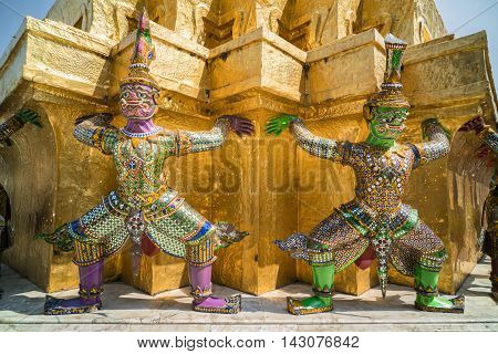 BANGKOK THAILAND - MARCH 9 2016: Thai colorful giants statue around Golden Chedi at Wat Phra Kaew in Bangkok Thailand.