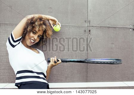 young stylish mulatto afro-american happy girl playing tennis, smiling, sport healthy lifestyle people concept