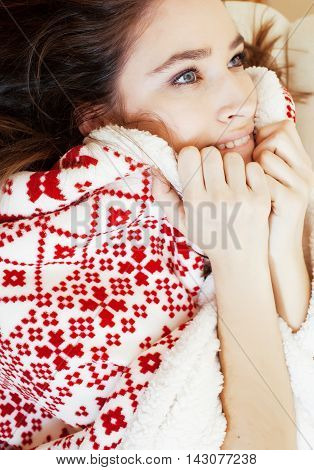 yong pretty brunette girl in Christmas ornament blanket getting warm on cold winter, freshness beauty concept close up