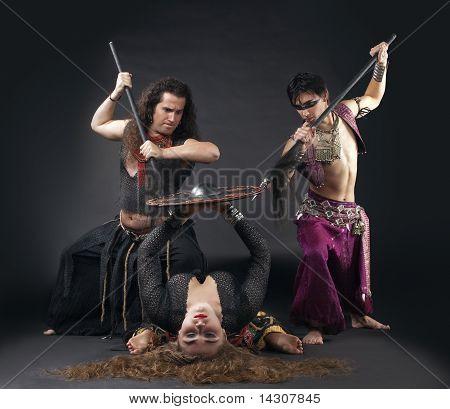Man with spike, woman with shield - ritual scene