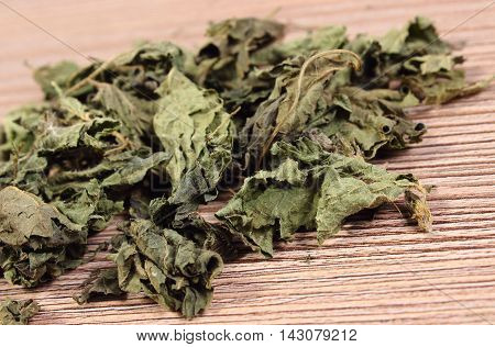 Heap Of Dried Nettle On Wooden Surface