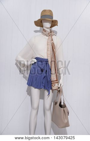 female clothing with scarf ,shoe ,bag on mannequin