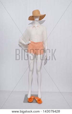 Full length female clothing with hat shoe on mannequin