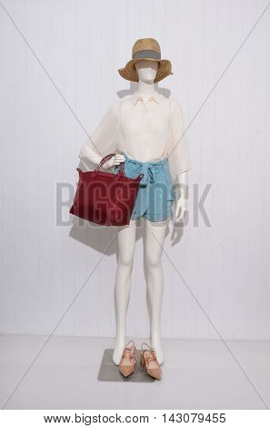 Full length female clothing with hat,shoe ,bag on mannequin