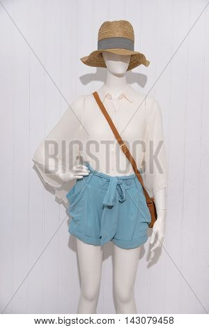 female clothing with hat,shoe ,bag on mannequin