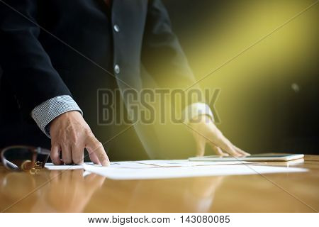 Business Man Stand At The Head Of The Table