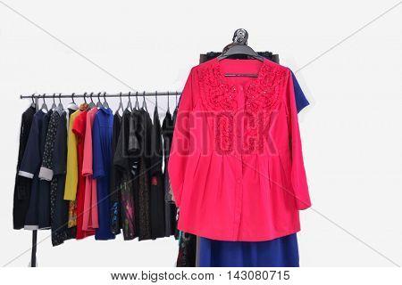 Set of female dress with,coat isolated on hanging