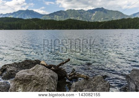 Blue lake in front of mountain landscape
