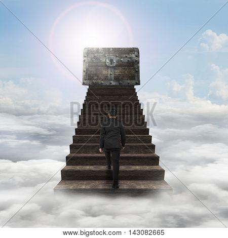 Man Walking Toward Treasure Chest On Top Of Wood Stairs