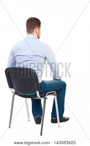 back view of business man sitting on chair.  businessman watching. Rear view people collection.  backside view of person.  Isolated over white background. Bearded businessman in white shirt sits on a