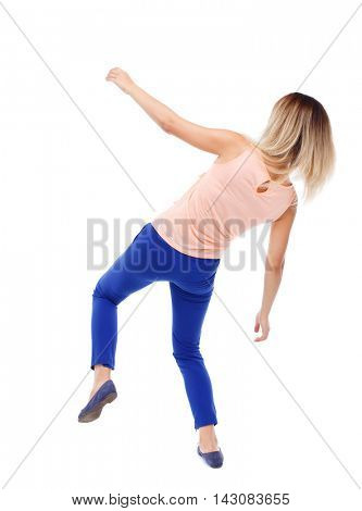 Balancing young woman.  or dodge falling woman. Rear view people collection.  backside view of person.  Isolated over white background. The blonde in a pink shirt and slipped down.