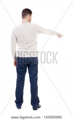 Back view of going  business man pointing. walking young guy . Rear view people collection.  backside view of person.  Isolated over white background. The bearded man in a white warm sweater shows