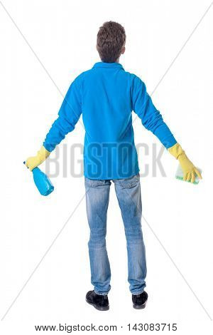 Back view of a cleaner man in gloves with sponge and detergent. girl  watching. Rear view people collection.  backside view of person.  Isolated over white Curly boy in a warm blue sweater accessories