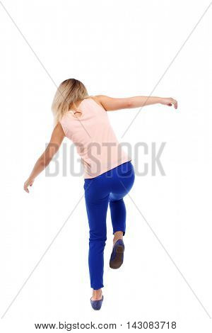Balancing young woman.  or dodge falling woman. Rear view people collection.  backside view of person.  Isolated over white background. The blonde in a pink shirt standing on one leg.