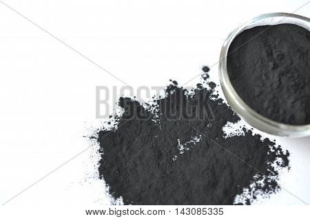 Powdered activated charcoal in a glass bowl