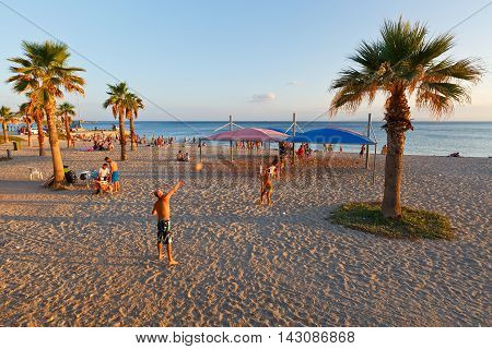 ATHENS, GREECE - AUGUST 13, 2016: People on the beach in Palaio Faliro in Athens, Greece on August 13, 2016.