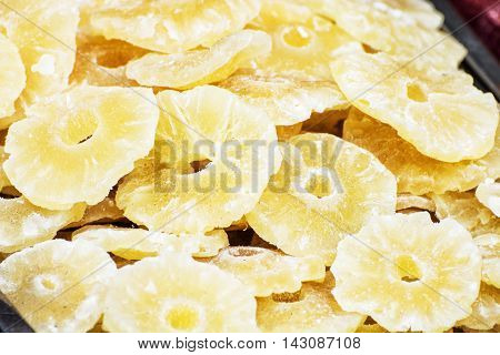 Dried sliced pineapple on the market place. Citrus fruits. Detailed food scene. Healthy food.