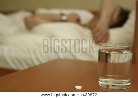 Tablet And Glass With Water On A Table