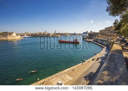 Valletta Malta - The Grand Harbour of Malta with ships and clear blue sky
