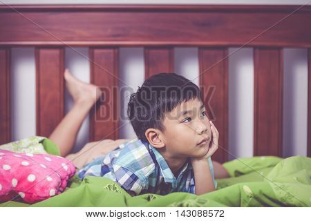 Sad Child Inside Bedroom. Problem Families Concept.