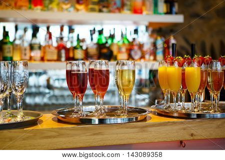 glasses of champagne, delicious punch and glasses of orange juice at the wedding reception. Glasses with alcohol and different drinks