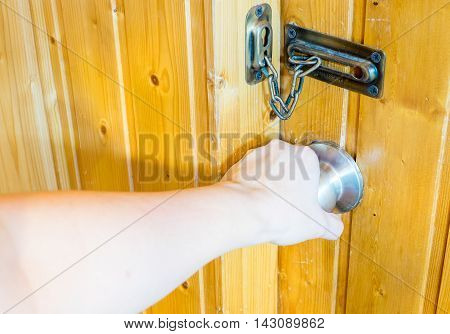 Hand Opening Door Knob Door At Wooden Room