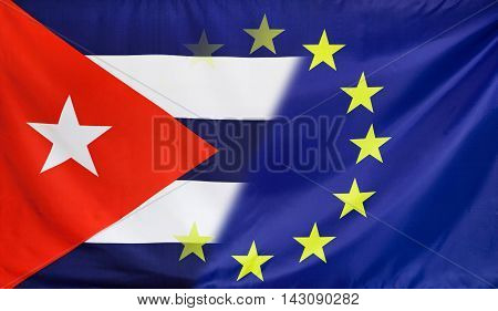 Cuba and European Union relations concept with diagonally merged real fabric flags