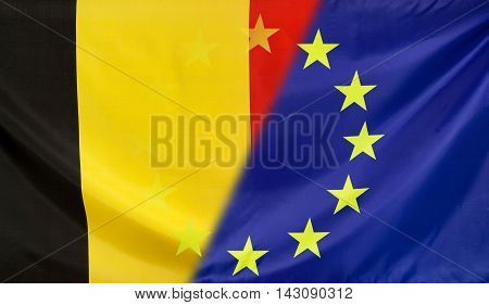 Belgium and European Union relations concept with diagonally merged real fabric flags