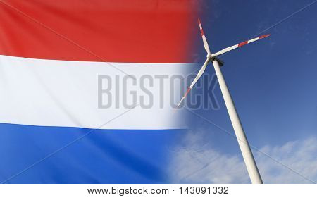 Concept clean energy with flag of Netherlands merged with wind turbine in a blue sunny sky