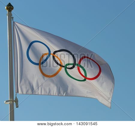 RIO DE JANEIRO, BRAZIL AUGUST 6, 2016: Olympic Flag at Copacabana Beach in Rio de Janeiro