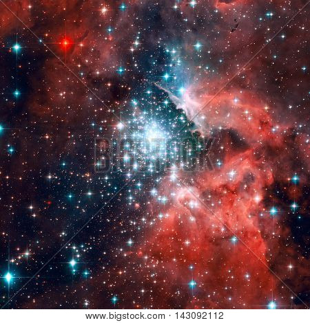 NGC 3603 is an open cluster of stars situated in the Carina spiral arm of the Milky Way around 20000 light-years away. Elements of this image furnished by NASA.