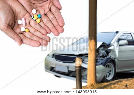 Car accident concept Take pills while driving is dangerous on the road
