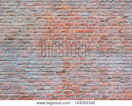 Old brick wall background with copy space. Full frame shot of a stone wall.